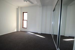 bedroom carpet floors mirror timber windows
